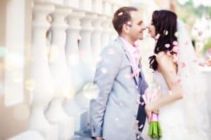 Couple at wedding with flower petals