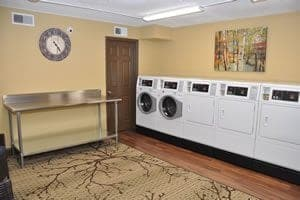 On-site laundry with washing machines and dryers