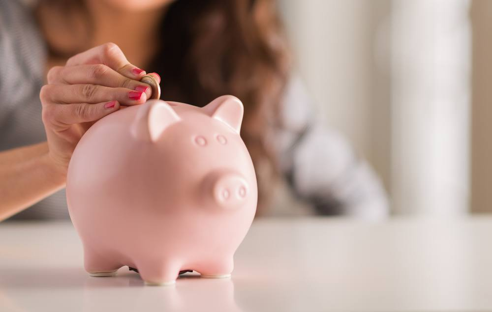 Adding money to a piggy bank