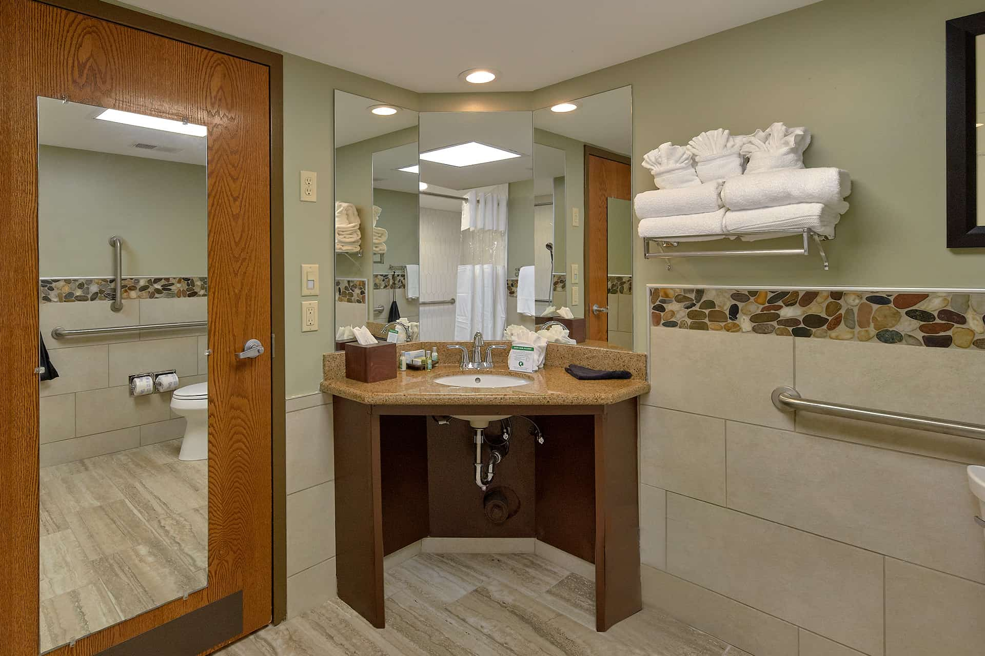 sink and mirrors in bathroom