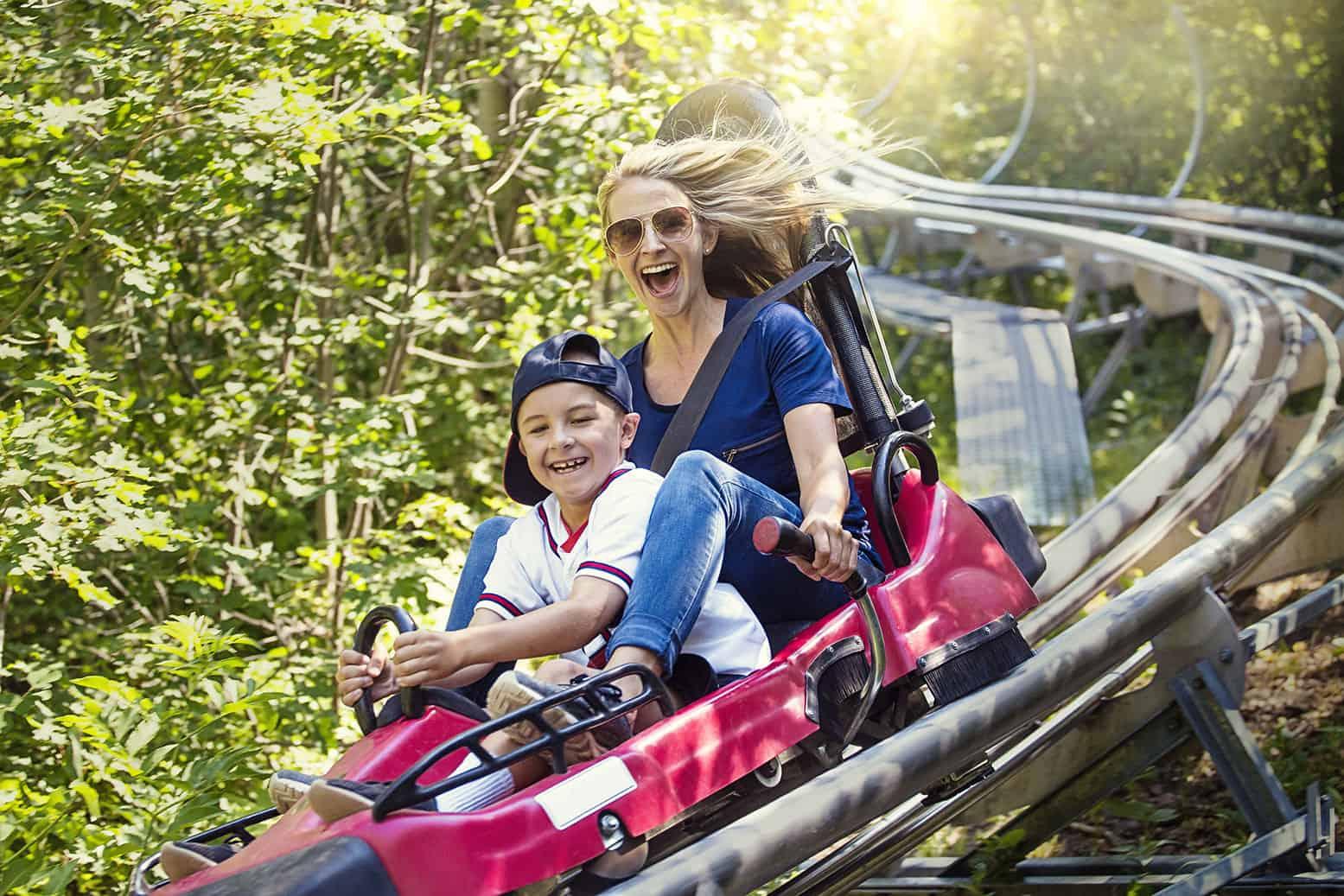 mom and son riding mountain coaster