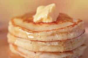 stack of pancakes with butter and syrup